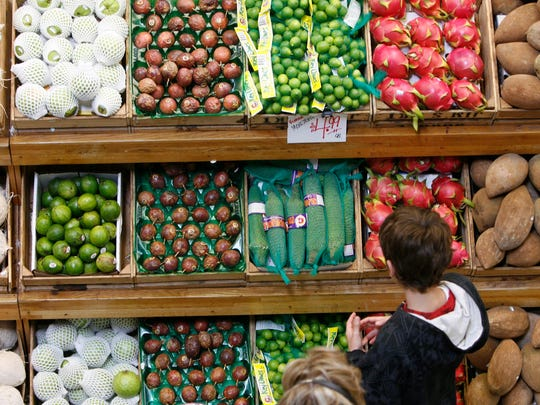 A customer eyes some produce in Jungle Jim's International Food Market in Fairfield , Ohio.