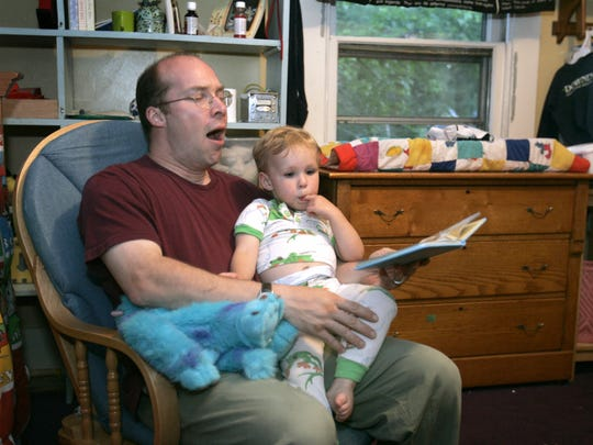 Phil Eichacker reads a bedtime story to son Ben Eichacker at about 9:20 p.m. in this 2006 file photo.