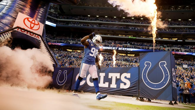 Indianapolis Colts outside linebacker Robert Mathis (98) is introduced before the start of  their NFL football game against the Jacksonville Jaguars Sunday, Jan.1, 2016, at Lucas Oil Stadium.