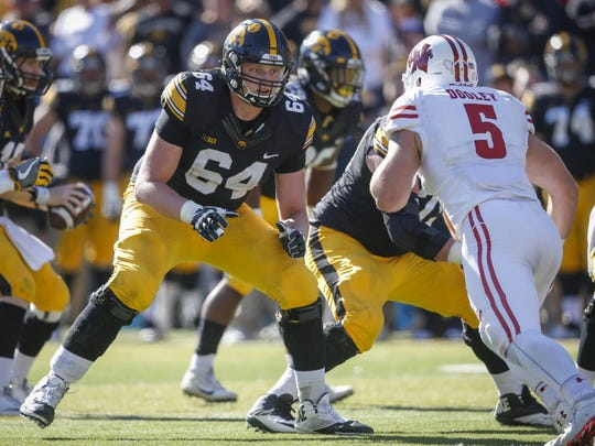 Iowa offensive lineman Cole Croston (64) will likely get one more game in his Hawkeye career. He was working with the No. 1 unit in Wednesday's practice at right tackle.