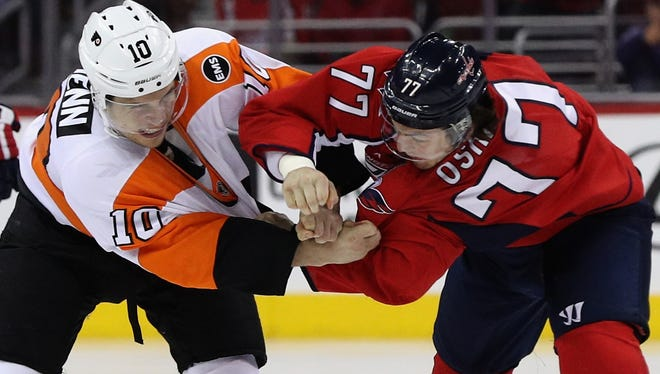 Brayden Schenn fought T.J. Oshie to start Game 5 for a cross-check he had on Evgeny Kuznetsov earlier in the series.