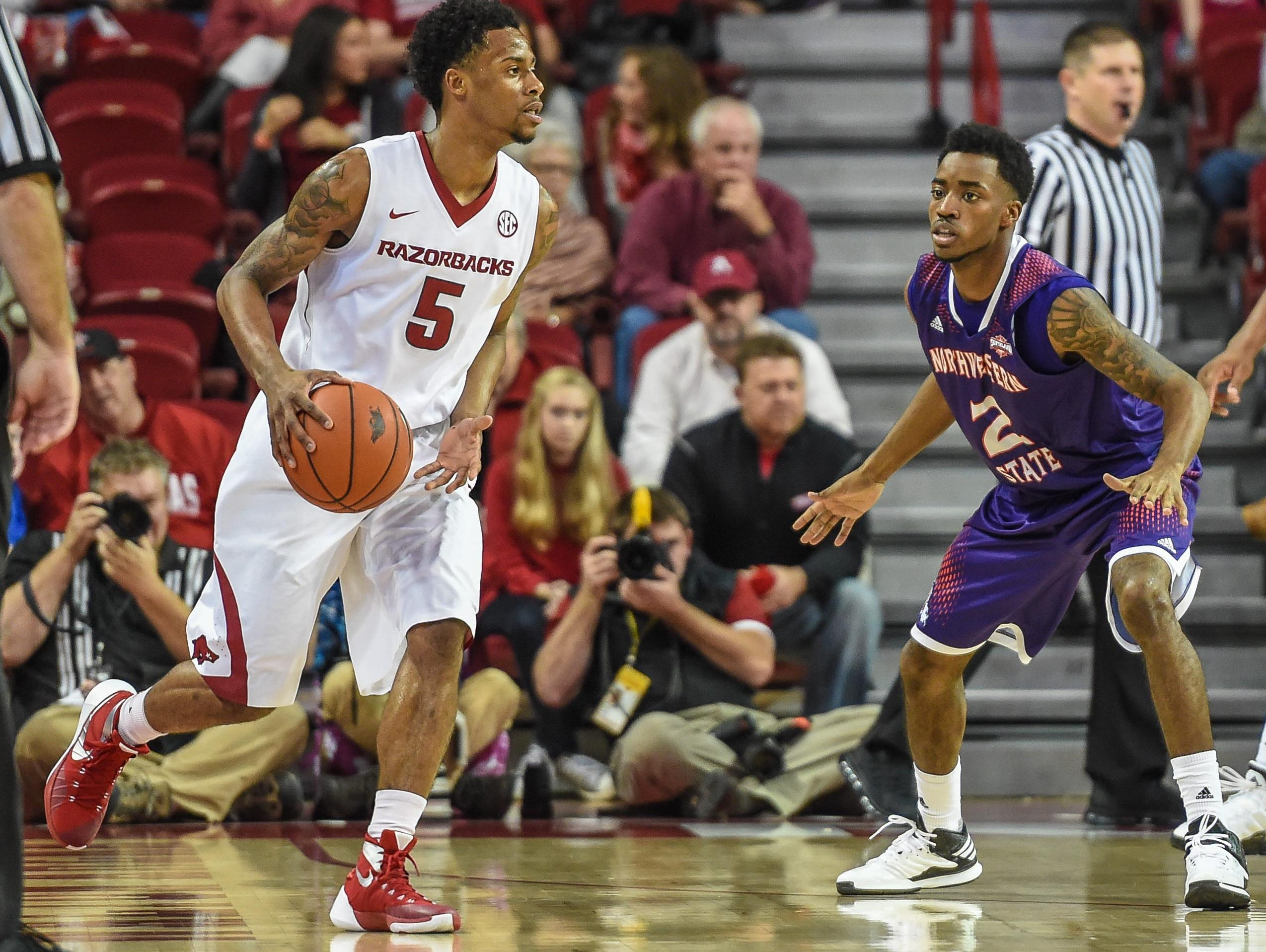 Arkansas guard Anthlon Bell (5) takes the ball downcourt during a game between the Razorbacks and Northwestern State on Tuesday.