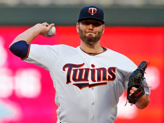 Minnesota Twins pitcher Lance Lynn throws against the Toronto Blue Jays in the first inning of a baseball game Monday, April 30, 2018, in Minneapolis.