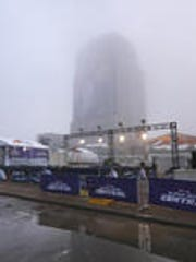 Fog hides the Lombardi Trophy that covers a building
