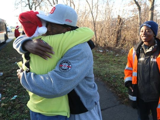 Mrs. Claus gets a big hug from William Calloway, 56,