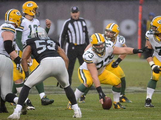 Green Bay Packers tackle JC Tretter (73), playing center for the injured Corey Linsley, calls out blocking assignments at the line of scrimmage against the Oakland Raiders at O.co Coliseum.