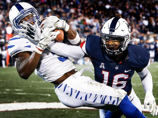 October 6, 2017 - Memphis receiver Anthony Miller sets a record for touchdown catches in a game, after grabbing his fourth in front of University of Connecticut defender Brice McAllister (right) during third quarter action in East Hartford, Conn. Miller, a former walk-on, holds Tigers single-season record for receiving yards.