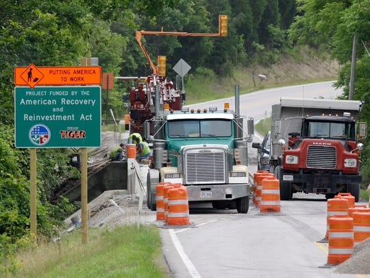 A sign identifies a bridge expansion project as funded by the American Recovery and Reinvestment Act near Warsaw, Ky., July 8, 2009.