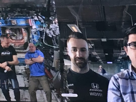 Astronauts A.J. Feustel (left) and Scott Tingle on the International Space Space, talk with IndyCar driver James Hinchcliffe and IndyStar Racing Insider Jim Ayello (right)