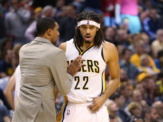 Injured Pacers guard George Hill gives teammate Chris Copeland a little advice during a timeout in the first half against the Bucks.