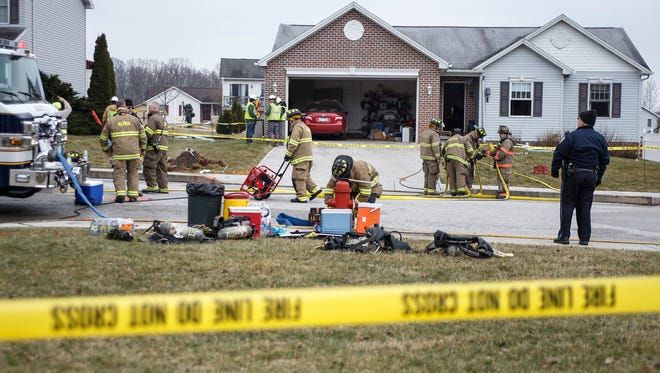 Firefighters observe the rear of a home after an explosion from a gas leak on Friday, March 4, 2016 in Littlestown, Pa. Emergency dispatchers say two people have been hurt in a house explosion in south-central Pennsylvania, but authorities couldn't confirm news reports that those injured were firefighters. (Dan Gleiter/PennLive.com via AP) MANDATORY CREDIT; MAGS OUT