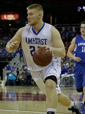 Amherst's Tyler Biadasz drives to the basket during  Thursday's WIAA Division 4 state boys' basketball semifinal game against Cameron at the Kohl Center in Madison.