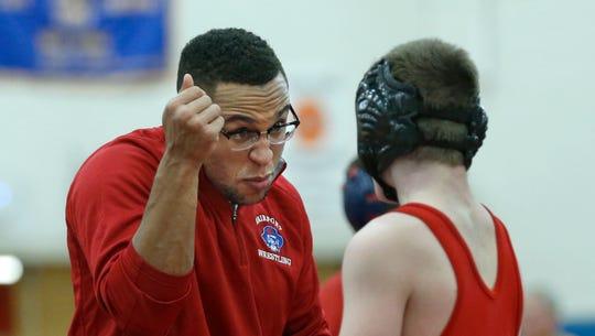 Fairport coach John Martin Cannon talks to Patrick