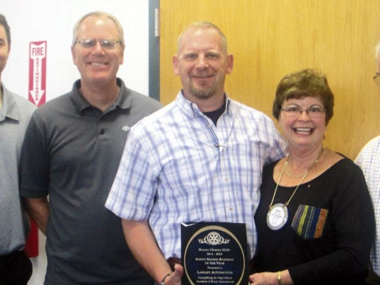 """Drew Terry, Toyota Representative, from left, Kevin Kavanagh and Paul Leetmae of Lawley Toyota receive the Sonny Brown """"Large Business of the Year Award"""" from Kathy Eaton and Peter Falley on Tuesday. Courtesy Photo"""