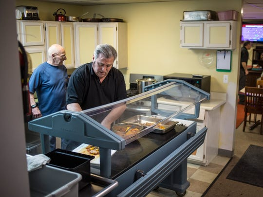 Director Arnie Koontz prepares dinner Wednesday, March 8, 2017 at the Blue Water Area Rescue Mission on 24th Street in Port Huron.