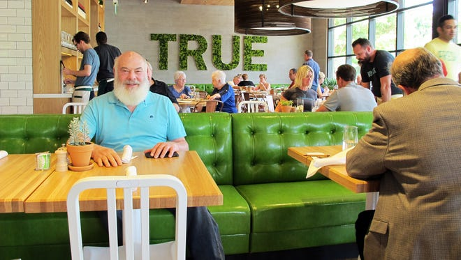 Dr. Andrew Weil, a celebrity holistic health guru, poses for a portrait Friday, March 24, 2017, at True Food Kitchen, a newly opened restaurant he co-created at Waterside Shops in Naples.