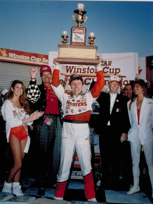 Alan Kulwicki hoists the 1992 NASCAR Winston Cup trophy at Atlanta Motor Speedway after winning the edging Bill Elliott by what was then the closest margin in championship history.