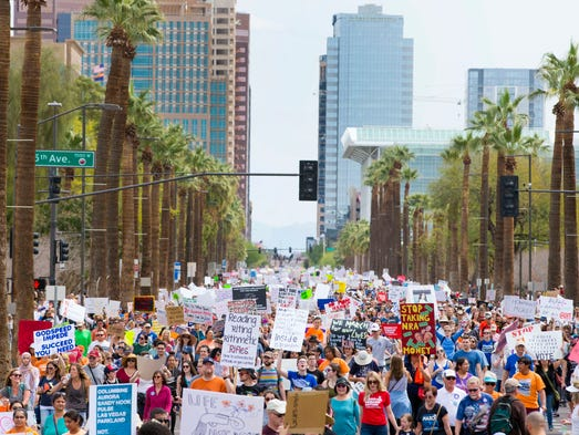 Thousands march in support of gun control during the
