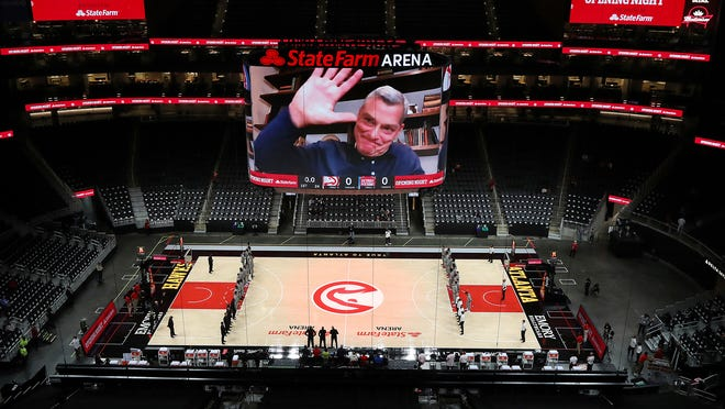 Atlanta Hawks owner Tony Ressler welcomes fans from the big screen for the Hawks' home-opener against the Detroit Pistons in December.