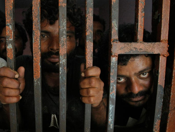 Arrested Indian fishermen in a cell at a police station