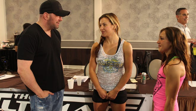 """UFC President Dana White talks to UFC women's bantamweight Miesha Tate (center) and prospective straw weight Chelsea Bailey at tryouts for Season 20 of """"The Ultimate Fighter"""" in Las Vegas."""