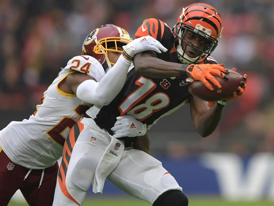 Cincinnati Bengals wide receiver A.J. Green (18) is defended by Washington Redskins cornerback Josh Norman (24) in the second quarter during game 17 of the NFL International Series at Wembley Stadium.
