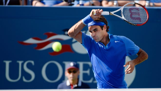 Roger Federer of Switzerland fires a forehand during his victory Tuesday against Grega Zemlja of Slovakia.