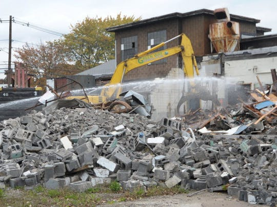 The E.C. Electroplating plant in Garfield being demolished in 2012. A $37 million plan to clean polluted groundwater under hundreds of neighboring homes has still not been funded.