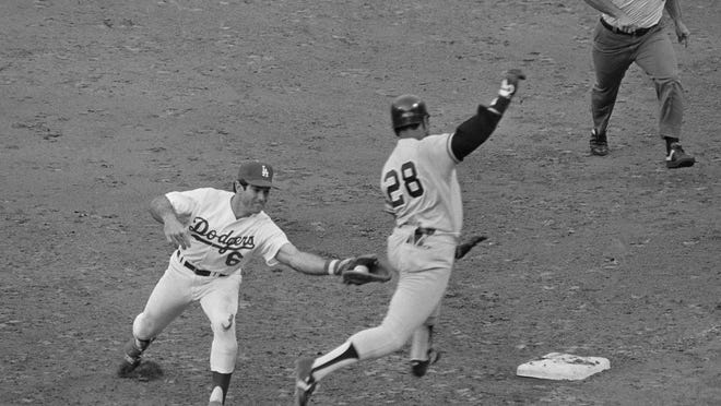 Los Angeles Dodgers first baseman Steve Garvey (6) reaches to tag New York Yankees batter Bob Watson at first base in the ninth inning of the World Series on Oct. 24, 1981, in Los Angeles, Calif.