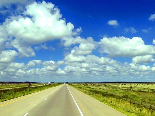 highway-open-road-blue-sky-north-dakota-getty_large.jpg