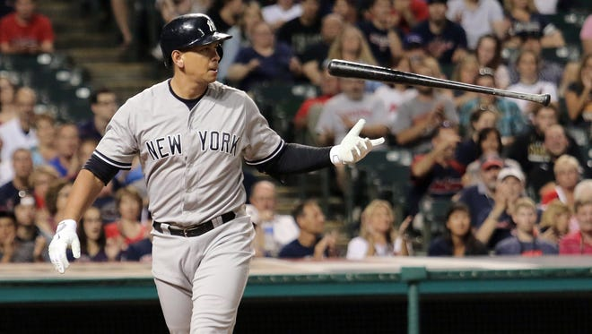 In this Aug. 13, 2015, file photo, New York Yankees Alex Rodriguez flips his bat after striking out in the eighth inning of a baseball game against the Cleveland Indians in Cleveland. Rodriguez says he plans to retire from baseball after the 2017 season. The Yankees slugger revealed his intentions Wednesday, March 23, 2016, during an interview with ESPN. His plans were confirmed by spokesman Ron Berkowitz.