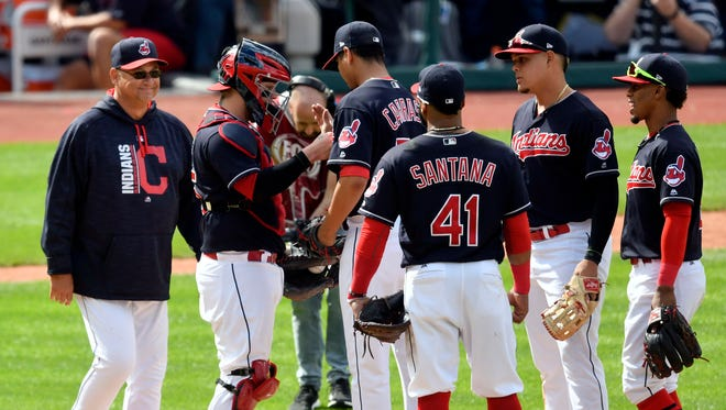 Cleveland Indians manager Terry Francona (left) walks to the pitchers mound during a pitching change in the ninth inning against the Minnesota Twins at Progressive Field.