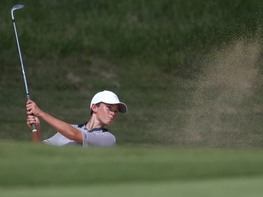 Patrick McCann of Maclay hits from a bunker during