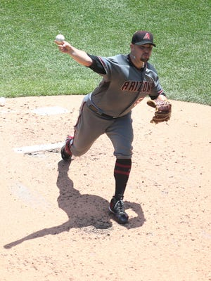 May 31, 2017; Pittsburgh, PA, USA;  Arizona Diamondbacks starting pitcher Zack Godley (52) pitches against the Pittsburgh Pirates during the fourth inning at PNC Park.