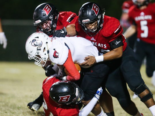 Ballinger defense tackles Sonora's Abel Cruz Friday,