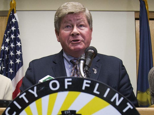 Special Advisor to Governor Rick Snyder Rich Baird speaks during a press conference held by Mayor Karen Weaver on July, 25, 2017 in Flint City Hall.