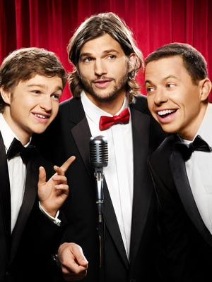 Ashton Kutcher, center, with Angus T. Jones  and Jon Cryer, stepped in after Charlie Sheen was fired.