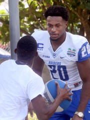 MTSU's Kevin Byard (20) plays some basketball with a boy from the Ranfurly Homes for Children during a Popeyes Bahamas Bowl community visit by MTSU and Western Michigan on Tuesday, Dec. 22, 2015.