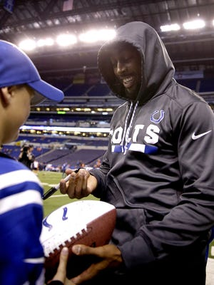 Tyler Beikes, 12, from Tucson AZ., gets an autograph from Indianapolis Colts T.Y. Hilton before the start of their game against the Denver Broncos at Lucas Oil Stadium Thursday, Dec 14, 2017.