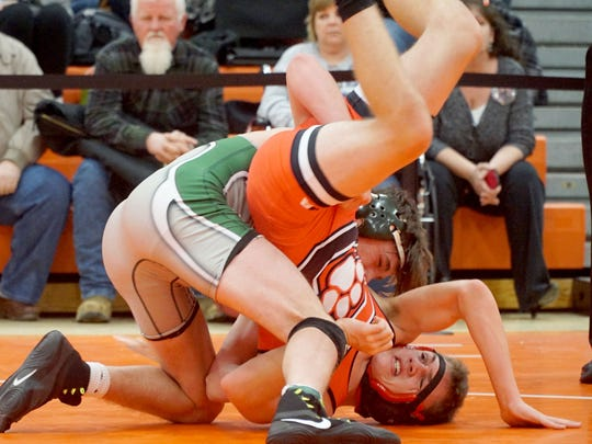 Madison's Carson Speelman has Crestview's Levi Kibler on his back during a 138-pound match Friday in the 55th J.C. Gorman Invitational at Mansfield Senior.