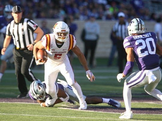 Iowa State Cyclones wide receiver Allen Lazard (5) tries to get away from Kansas State Wildcats defensive backs Elijah Walker (7) and Denzel Goolsby (20) in the first half at Bill Snyder Family Stadium. The Wildcats won the game 20-19.