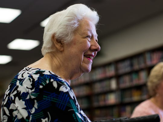 Betty London sits in the library of London High School