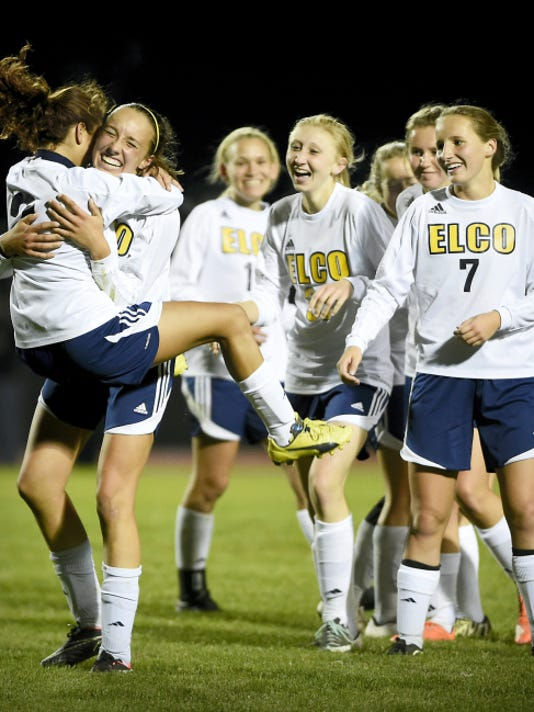 Elco's Kiyana Rodriguez jumps into the arms of teammate Ryelle Shuey after Shuey scores the game-winning goal in a 3-2 win over Schuylkill Valley in the opening round of the District Three Class AA playoffs on Monday night.