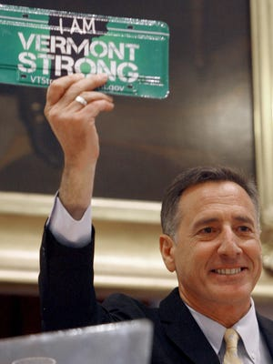 Gov. Peter Shumlin holds a license plate during his State of the State address Jan. 5, 2012. The plate was produced to raise money after Tropical Storm Irene battered Vermont.