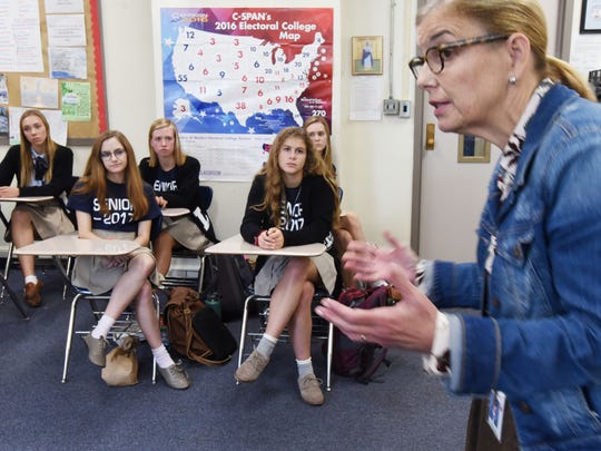 Loyola College Prep's Mary Beth Fox talks to her students