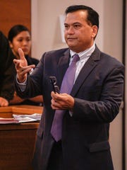 """Defense attorney Joaquin """"Jay"""" Arriola questions a witness during the murder trial of his client, former Guam police officer Mark Torre Jr., at the Superior Court of Guam on Wednesday, Feb. 15, 2017.  Torre is on trial for the July 2015 shooting death of fellow police office, Sgt. Elbert Piolo."""