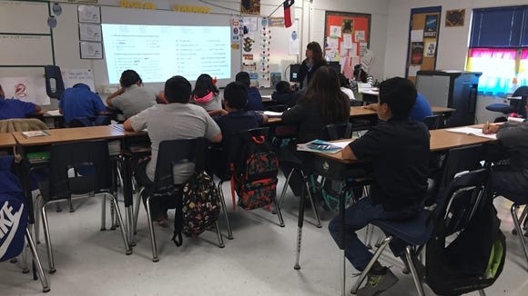 Students in a fifth-grade WIN Academy class practice vocabulary at Robert R. Rojas Elementary School on Oct. 12.