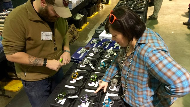 Elizabeth Montgomery of Staunton attended her first gun show on Saturday in Fishersville. She said she wanted to buy a gun to protect herself and her family.