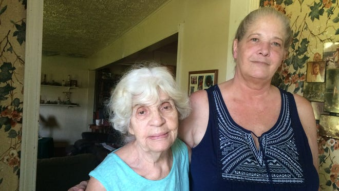 Jane Stokes and Catherine Lynch in their home Friday, June 10, 2016. The women told law enforcement officers to go ahead and arrest them after they refused to leave a condemned home.