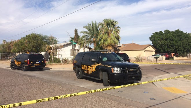 Sheriff's deputies at the scene of a double shooting on Oct. 28, 2016, in the 9200 block of South Calle Sahuaro in Guadalupe.
